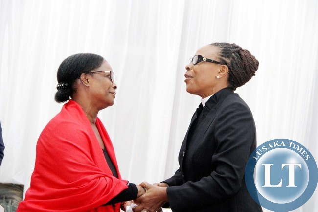 CCZ Secretary General Suzanne Matale with First Lady Esther Lungu during the funeral service of Late Rev Violet Sampa Bredt at St Pauls UCZ Church in Lusaka on April 10,2015 -Picture by THOMAS NSAMA