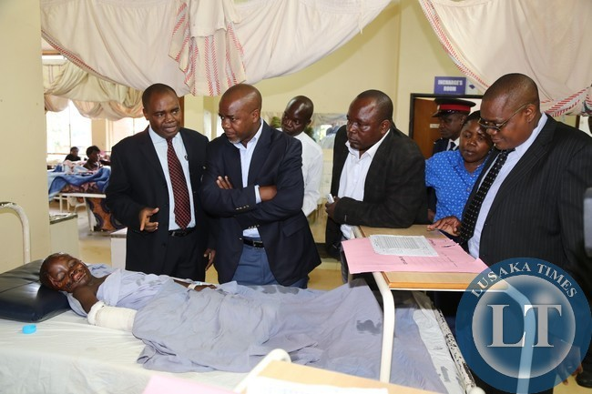 ,UTH head clinical care Dr Lastone Chikoya shows Lusaka Province Permanent Secretary Stardy Mwale one of the accident victims Moffat Chipasha during the visit of the Mazabuka and kafue accident victims at the University Teaching Hospital