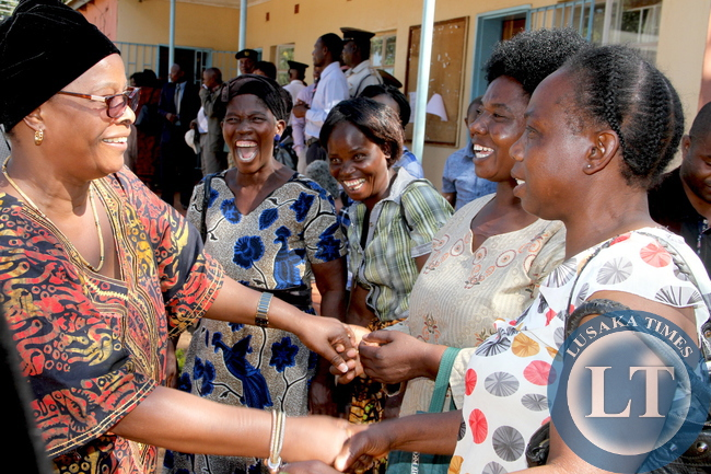 First Lady Esther Lungu Lungu share a light moment with women on arrival in Nyimba District for the Outreach Programme for People with Special Needs on May 18,2015 -Picture by THOMAS NSAMA