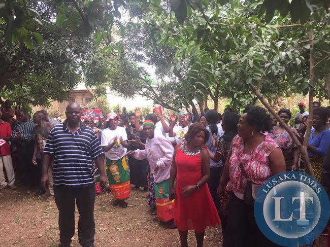 UPND President Hakainde Hichilema  interacts with residents in Linda compound