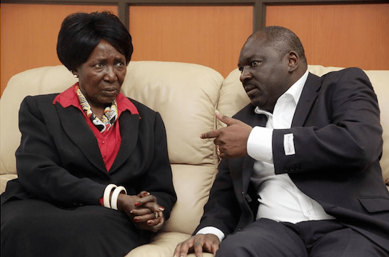 Vice President Inonge Wina and PF Secretary general Davies Chama confer
