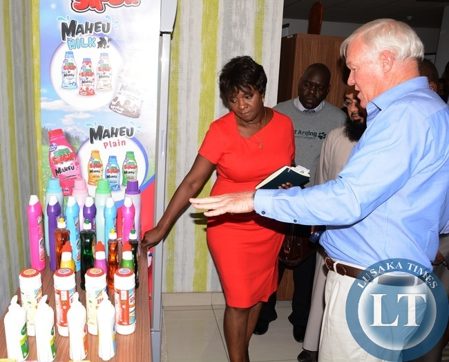 Trade Kings Managing Director Allan Jackman showing Commerce Minister Margaret Mwanakatwe some of the products during the tour of Trade Kings