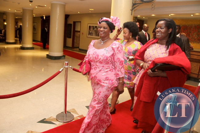 First Lady Esther Lungu with Ministry of Health's Dr Sharon Kapambwe  at Inter Continental Hotel shortly before she left  for Dinner Hosted by Kenya's President Uhuru Kenyatta in honour of First Ladies attending  the 9th Stop Cervical, Breast and Prostate Cancer in Africa Conference in Nairobi on July 20,2015 -Picture by THOMAS NSAMA