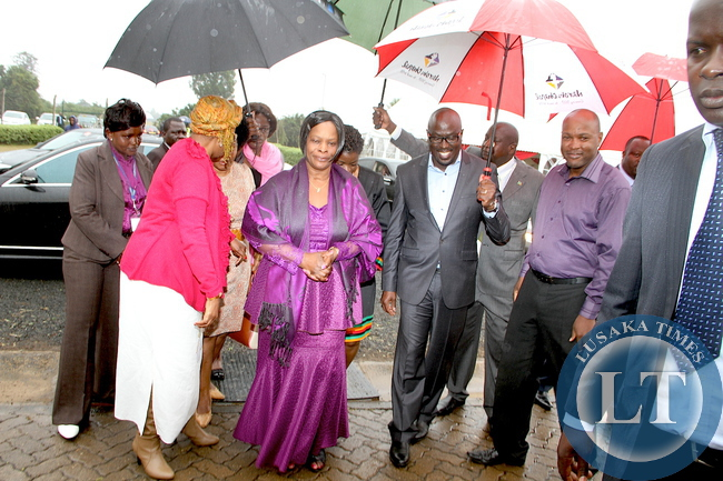 First Lady Esther Lungu flanked by Executive Pastor Rev Nick Korir  (second from right) and Pastor  Gowi Odera (r)  on arrival at Nairobi Chapel for  Church service  on July 19,2015 -Picture by THOMAS NSAMA