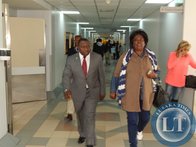 FOREIGN Affairs Minister, Mr. Harry Kalaba (left) with Tourism and Arts Minister, Ms. Jean Kapata arrive to see Archbishop Mpundu at Milpark Hospital in Johannesburg on 22nd July, 2015