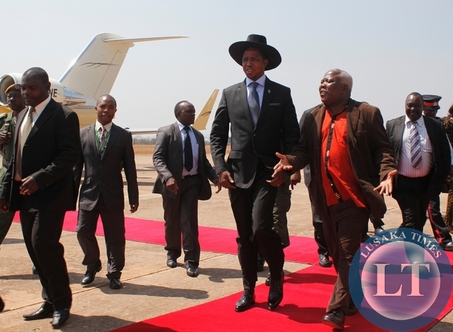 President Edgar Lungu with Northern Province Minister, Freedom Sikazwe on arrival at Samora Machel Airbase from Uganda when the president made a stop over in Mbala on his way to Mwansabombwe
