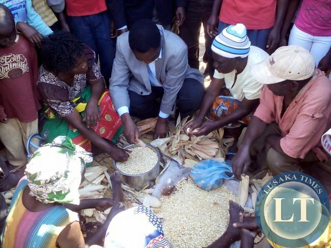 UPND president Hakainde Hichilema interacts with women in Kabuta village,Luapula province