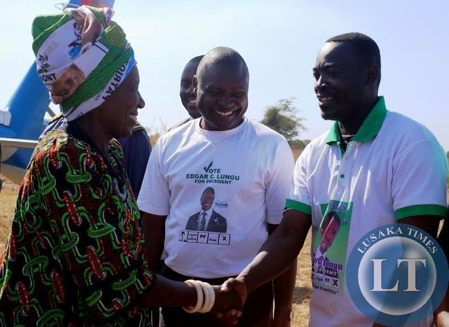 VICE President  inonge wina shake hands with PF bangweulu candidate Anthony Kasandwe on arrival in Samfya to drum up support for August 6 by election. Looking on is Fr. Frank  Bwalya