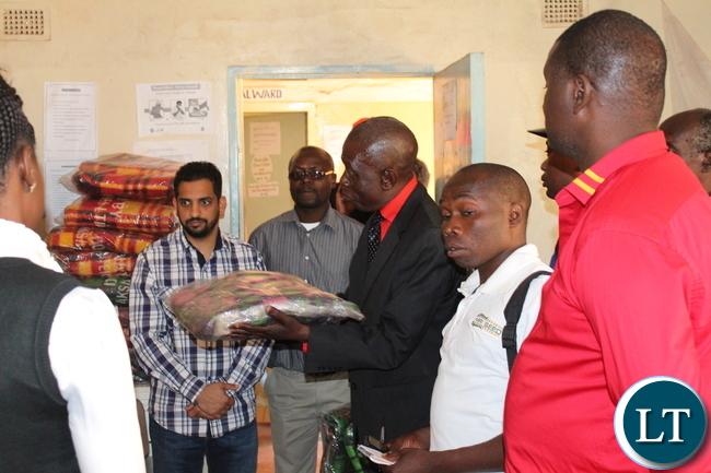 AKSA ltd. Director Khalid Isane(l) looks on whilst Mkushi DC Luka Mwamba(r) inspects the donated blankets at Mkushi Hospital. by Chiza Muzia,ZANIS.