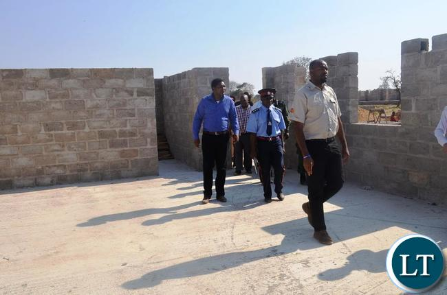 Eastern Province Minister Malozo Sichone with Provincial Deputy Permanent Secretary Patrick Mwanawasa when they inspected a K44 million project of a boarding school under construction in Chasefu of Lundazi District