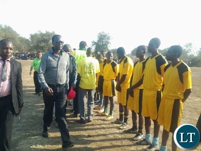 Eastern Province Permanent Secretary Chanda Kasolo with Mambwe Warriors FC Players before the kick off of a final between Warriors and Dushambe FC at a Kavulamungu sponsored tournament