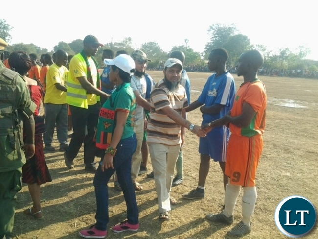 Kavulamungu Group of Companies director Khalid Mitha greeting Dushambe FC before the kick off between Dushambe and Mambwe Warriors FC in Mfuwe