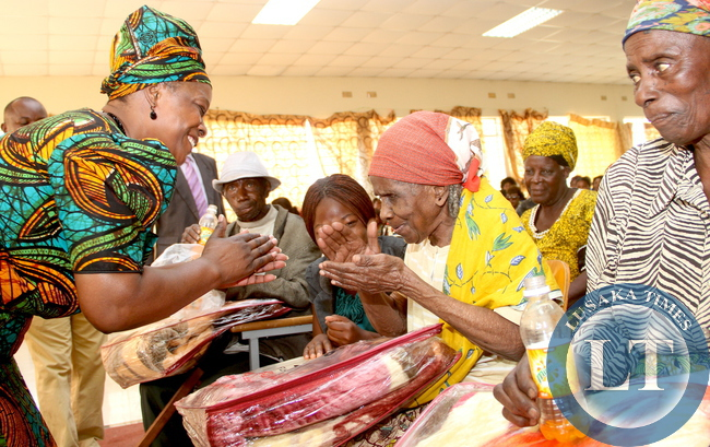 First Lady Esther Lungu donates blankets to the aged in Kaoma District during the outreach programme for People with Special needs on Saturday, August 15,2015 -Picture by THOMAS NSAMA/ STATE HOUSE