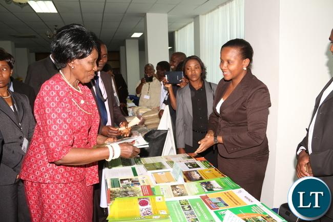 Ugandan PELUM Country RepresentativeCoordinator distributes an Agriculture booklet to Veep and Acting President Dr Inonge Wina