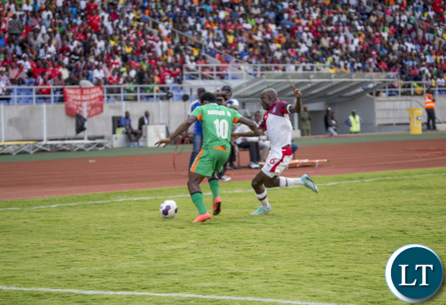Zesco United striker Winston Kalengo (l) battles for the ball with Nkana defender Donashano Malama