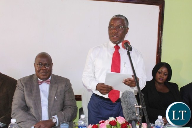 SOUTHERN Province Minister Nathaniel Mubukwanu addresses the participants (not in Picture) for Southern Women Economic Empowerment Expo workshop at Woodlands lodge in Livingstone On the left is Southern province Permanent Secretary Sibanze Simuchoba and Gender Rights Protection Director Pumulo Mundale (r).