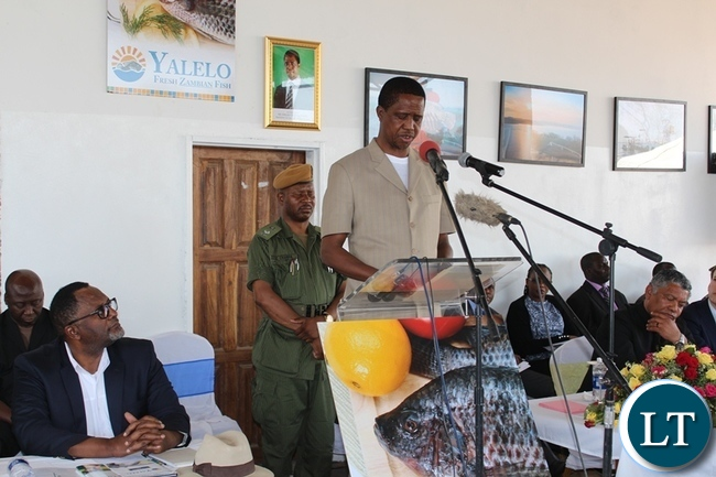 PRESIDENT Edgar Lungu gives his speech while Yalelo Fresh Zambian Fish Company Director Fisho Mwale (l) and Company Board Chairman Adam Taylor (r) listen. This was during the official opening of the fish farming firm at Kamimbi village in Siavonga district