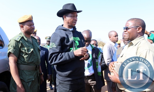 resident Edgar Lungu with Pf Candidate Anthony Kasandwe at Chinsaka Primary School In Kapata Ward East one in Bangweulu By Election . Picture by Eddie Mwanaleza/ Statehouse.03-08-2015.