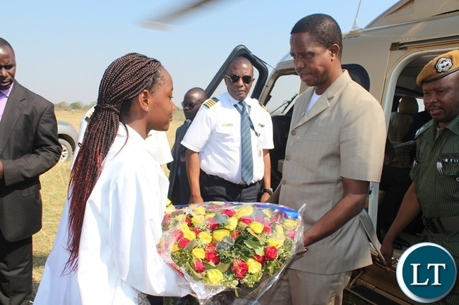 PRESIDENT Edgar Lungu receives a banquet of flowers from a 13 year old Stephane Mulenga when he arrived at Kamimbi village in Siavonga district on Thursday. The president was in Siavonga to officially open Yalelo Fresh Zambian Fish Company