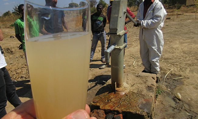 Water from a borehole drilled by KCM at Shimulala village, Zambia. Photograph: John Vidal for the Observer