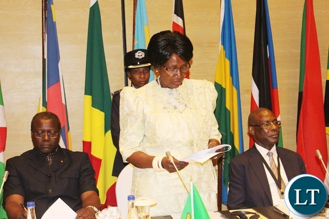 VICE President Inonge Wina gives her speech during the official opening of International Conference on the Great Lakes Region (ICGLR) meeting of Ministers of Justice on domestication of ICGLR of protocols at Zambezi Sun Hotel in Livingstone Yesterday. On the right is Justice Minister Ngosa Simbyakula and ICGLR Secretary General Antonio Bembe.