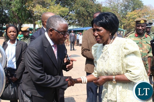 VICE President Inonge Wina (r) shakes hands with Southern Province Minister Nathaniel Mubukwanu shortly before leaving for Luasaka at Hurry Mwaanga Nkumbula International Airport in Livingstone. The Vice President was in Livingstone to officially open the International Conference on the Great Lakes Region (ICGLR) meeting of Ministers of Justice on domestication of ICGLR of protocols.