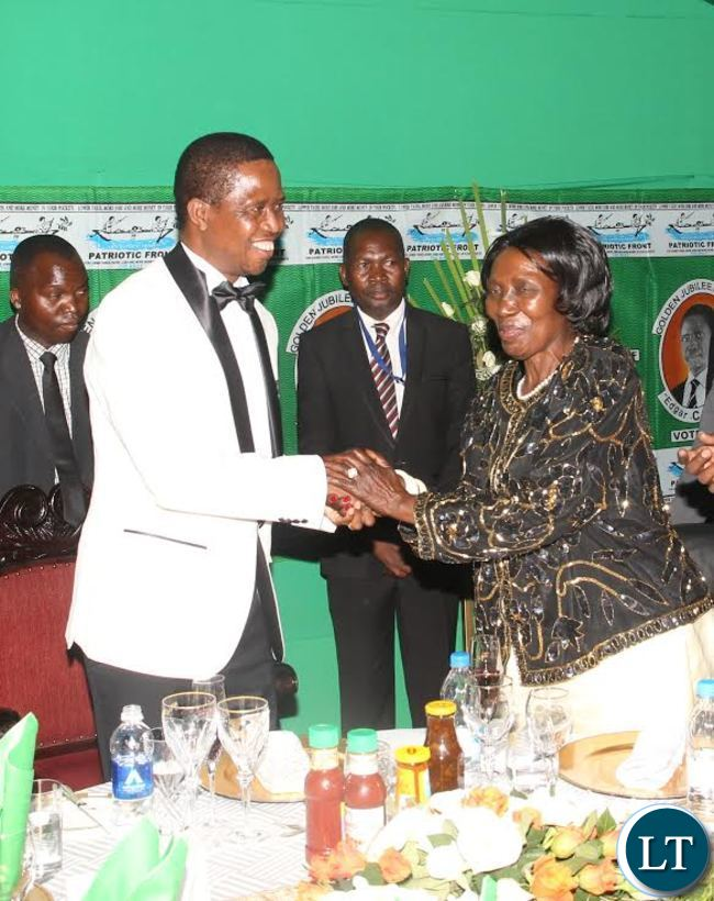 President Edgar Lungu (L) shake hands with Vice-President Inonge Wina(R) during ''Meet The President Fundraising Dinner'' at Mulungushi International Conference Centre