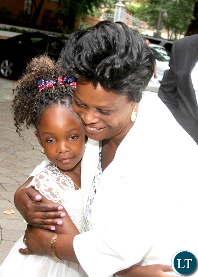 First Lady Esther Lungu embraces 6 year-old Greta Kalinda on arrival in Dallas-Texas for the Global Women's network summit organized by the George W. Bush Institute on Sunday, September 20,2015 -Picture by THOMAS NSAMA