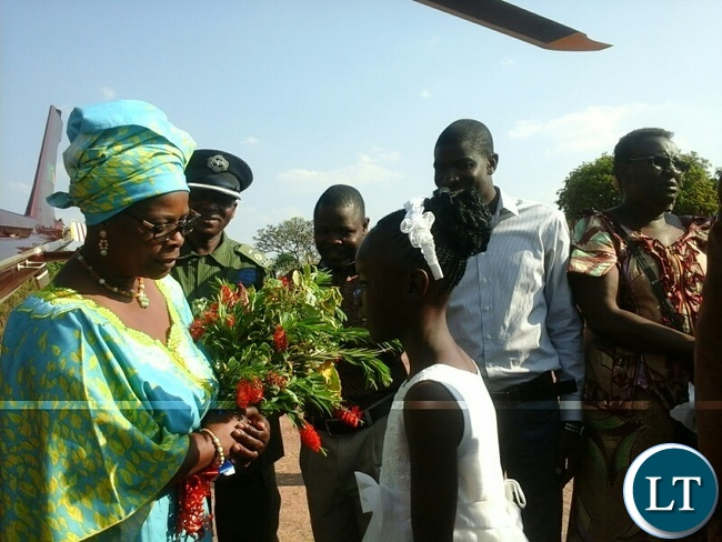 First lady easter Lungu receiving flowers on arrival at airstrip in itezhi tezhi yesterday during her visit. Picture by SYLVIA MWEETWA