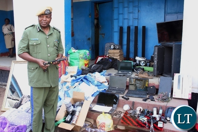 Western Province Police Commissioner Charles Lungu gives details of the stolen property during a stolen property identification display at Mongu Central Police