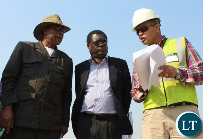Rankin Consultant Company Resident Engineer Salah Gad (r) briefing Zambezi Region Council Leadership of Namibia, Governor Col. Lawrence Sampofu (l) and Mongu District Commissioner Susiku Kamona (c) before touring the 8000 Link Zambia Mongu- Kalabo Road Project