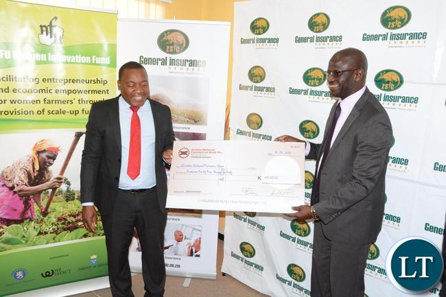 General Insurance Limited Managing Director Charles Nakhoze handover the cheque of K45, 000 to Zambia National Farmers Union Executive Director Ndambo Ndambo towards its Annual Congress preparations to held soon