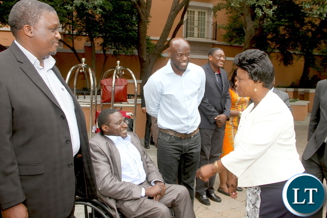 First Lady Esther Lungu talks to a Zambian living in Texas Daniel Nsomekela (in wheelchair) on arrival in Dallas-Texas for the Global Women's network summit organized by the George W. Bush Institute on Sunday, September 20,2015 -Picture by THOMAS NSAMA