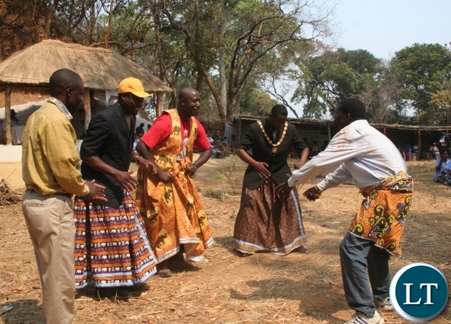 Justice Minister Dr Ngosa Simbyakula (l) with Mkambi traditional ceremony national chairperson Lemmy Kajoba and Acting Solwezi mayor Brian Kajoba join Blackson Mwenda (l) in dancing hunters song locally known as Katembo dance during the Mkambi tradition ceremony at senior chief Mujimanzovu in Solwezi