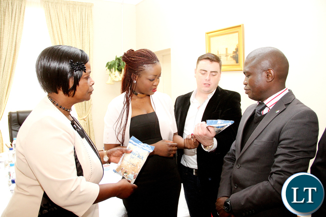 First Lady Esther Lungu with Australian Businessman Brendan Clark and his wife Portia Clark founders of the NGO Health Hope Zambia and UTH Public Relations manager Mwenya Mulenga (r) during the handover of Hospital equipment and nutritional food for children donated by Australian Government to the First Lady at State House on Friday, September 4,2015 -Picture by THOMAS NSAMA