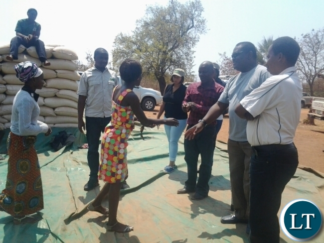 Food Reserve Agency executive director Chola Kafwabulula greeting Chankhanga clerk Hope Mwape in Chipata