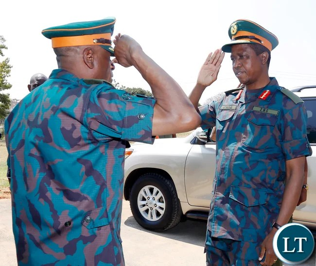 President Edgar Chagwa Lungu (L) is saluted by ZNS Commander General Nathan Mulenga (R) during commissioning of earth moving equipment in Lusaka, Chamba Valley on Tuesday 8th September 2015, PICTURE BY EDDIE MWANALEZA-STATE HOUSE