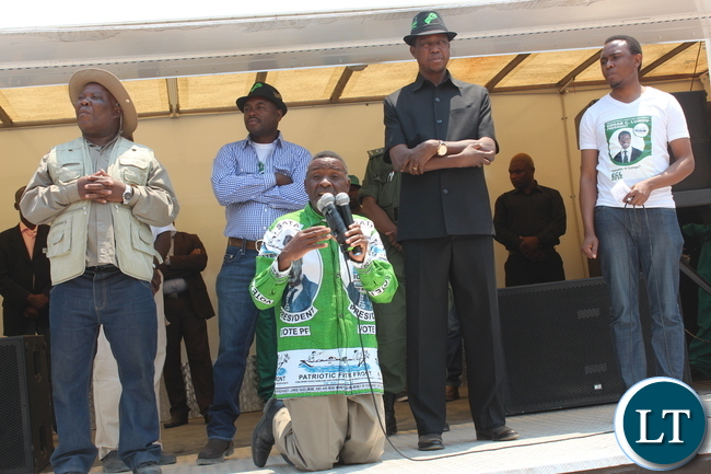 President Edgar Lungu with PF Lubanseshi candidate George Mwansa when he address a huge rally at Mucheleka Primary School today. looking on is campaign manager Freedom Sikazwe, Mwansabombwe MP Rogers Mwewa and Deputy Campaign Manager Fr. Frank Bwalya :Picture by Mary Bwembya (ZANIS)