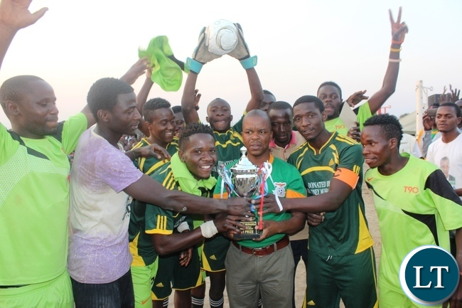 Education deputy Minister Sydney Mushanga (centre) presenting the trophy to Super Lion, who were the overall winner of the Sydney Mushanga sports tournament