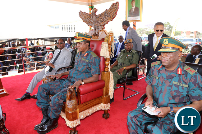 President Edgar Chagwa Lungu (C) with Defence Minister Richwell Siamunene (R) and ZNS Commander General Nathan Mulenga during the commissioning of earth moving equipment in Lusaka, Chamba Valley, on Tuesday, 8th September 2015 PICTURE BY EDDIE MWANALEZA-STATE HOUSE