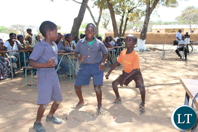 School children entertaining the crowd that came to witness the official hand over of five computers to Namuseba Primary School in Monze District by Zambia National Building Society (ZNBS)