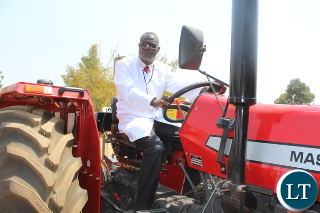 FEELING LIKE A FARMER! AGRICULTURE and Fisheries Permanent Secretary Dr David Shamulenge have a feel of the new tractor bought by the Zambia College of Agriculture (ZCA) at a cost of K230,000. This was after he toured the learning institution's farm