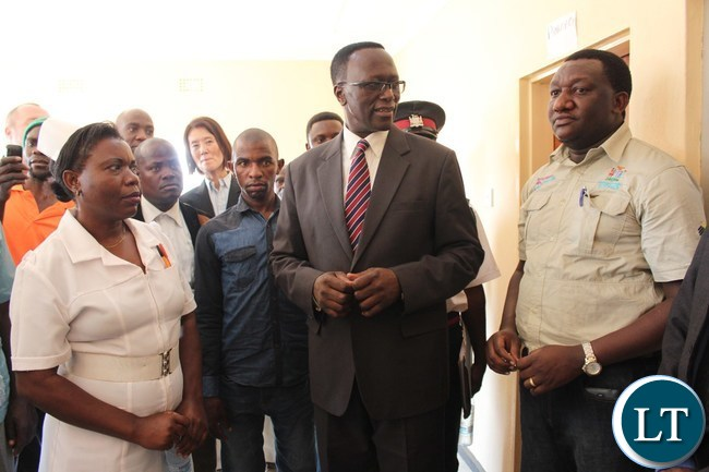 EASTERN Province Permanent Secretary, Chanda Kasolo (c) flanked by regional Medial Officer, Dr. Abel Kabalo and Dwankhozi health post Nurse –in- Charge, Beauty Jere, during the tour of the facility after it was handed over to the community following the construction by JTI