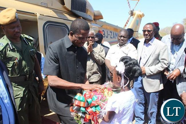 PRESIDENT Edgar Lungu receives a banquet of flowers from an Eight years old Judith Chilufya at Sinazeze school ground in Sinazongwe district