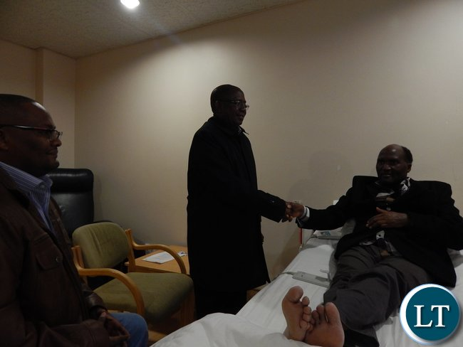 Foreign Affairs Deputy Minister, Mr. Rayford Mbulu, bids farewell to Lusaka businessman, Mr. Edgar Ngoma at Morningside Clinic in Johannesburg, South Africa. Looking on is Zambia's High Commissioner - Designate to South Africa, His Excellency Mr. Emmanuel Mwamba.