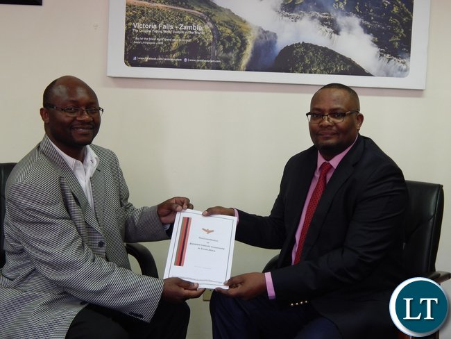 Chairperson of the organisation Mr. Chimwemwe Mtonga presenting a copy of their constitution to the High Commissioner.