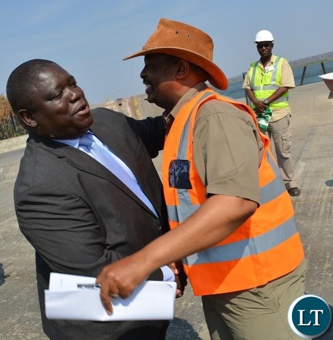 Zambia's Transport, Works, Supply and Communication Minister Yamfwa Mukanga (left) hugs Botswana Minister for Transport and Communications Tshenolo Mabeo (right) during an inspection of Kazungula Bridge project on