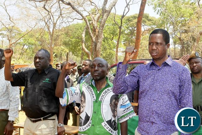 From Right to Left: President Edgar Chagwa Lungu, Solwezi West Parliamentary Candidate Martin Mbaya and Patriotic Front (PF) Secretary General Davies Chama sing the National Anthem before the start of the rally at Matebo grounds in Solwezi West Constituency on Monday, September 14,2015. PICTURE BY SALIM HENRY/STATE HOUSE ©2015