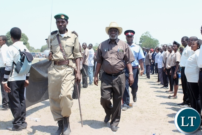 Labour Minister Fackson Shamenda (c) inspecting the parade mounted by marchers during the 51st Independence Anniversary celebrations at Mongu Sports Stadium