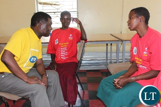 Mongu District Commissioner Susiku Kamona (l) interacting with female mental patients during the commemoration of World Mental Health Day at Lewanika General Hospital in Mongu